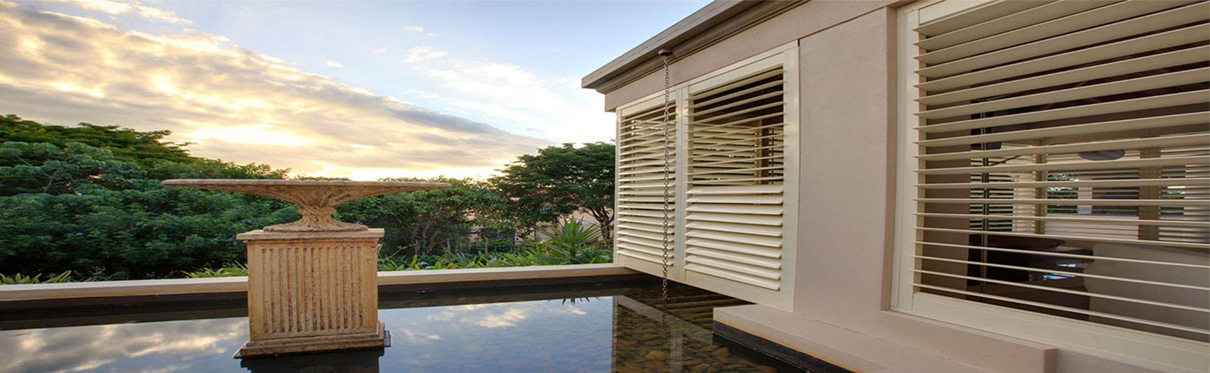 Outdoor Poolside Patio Living with Ambient Aluminium Security Shutters as the Feature